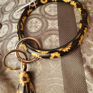 Huge and gorgeous sunflower ring/ tassle key chain